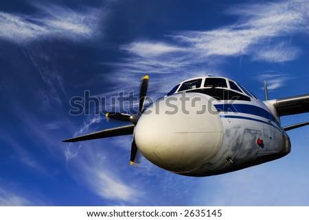 Flying Soviet airplane AH-246 in blue sky - stock photo