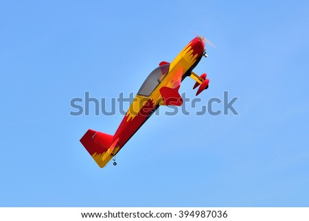 Flying the plane performs aerobatics in the sky - stock photo