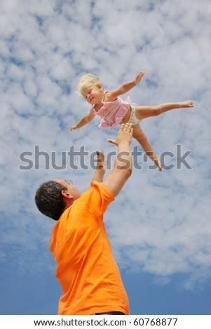 flying toddler girl on sky background - stock photo