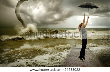 flying up girl with umbrella over sea tornado  background - stock photo