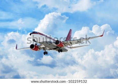 flying up passenger airplane in cloudy sky - stock photo