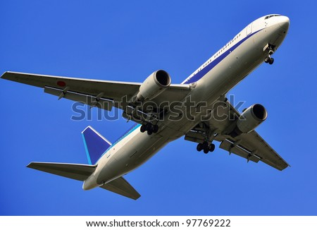 flying up passenger airplane isolated over blue sky background - stock photo