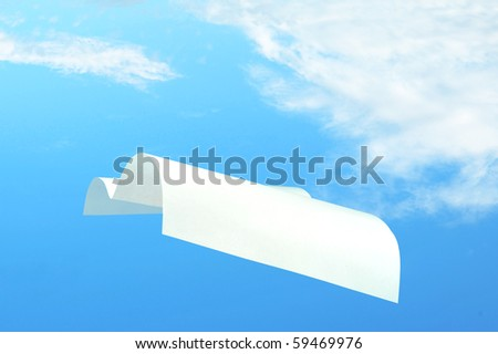 Flying White paper over a blue sky - stock photo