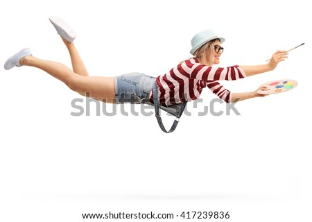 Flying young woman with a paintbrush and a palette isolated on white background - stock photo