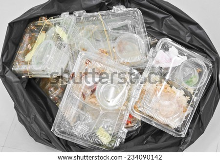foam and plastic food container in the bin / environmental problems