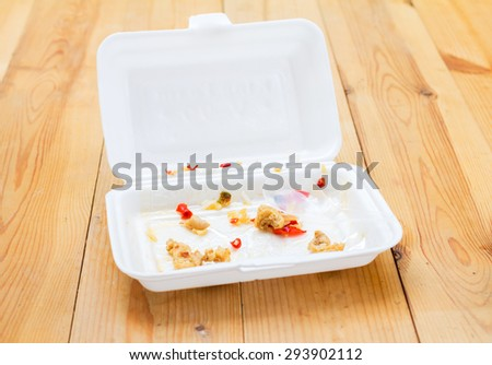 foam boxes with scraps left over from eating - stock photo