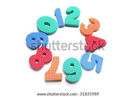 Foam Numbers Arranged in Circle on White Background