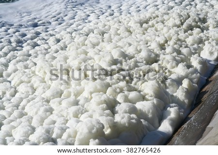 Foam on the lake surface. - stock photo