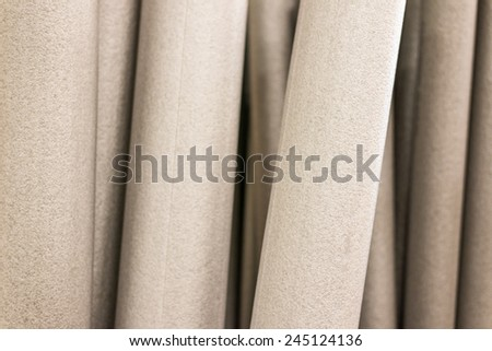 Foam tubes in the warehouse, close up view - stock photo