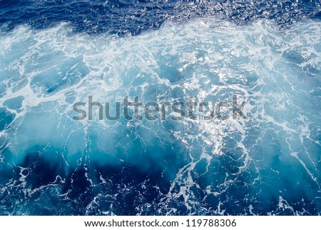 Foamy surface of sea water, shot in the open sea directly from above - stock photo