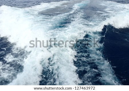 Foamy wake behind the stern of the ship - stock photo
