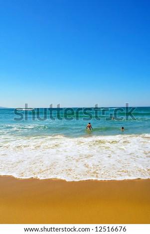 Foamy wave runs on St. Lucia beach. Shot in Sodwana Bay Nature Reserve, KwaZulu-Natal province, Southern Mozambique area, South Africa. - stock photo