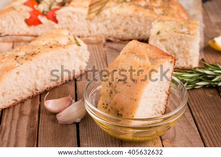 Focaccia Bread Appetizers. Focaccia Bread flavored with herb seasoning and topped with Cherry Tomatoes, Rosemary and Olive oil. - stock photo