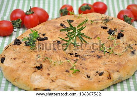 Focaccia Bread with tomatoes and herbs - stock photo
