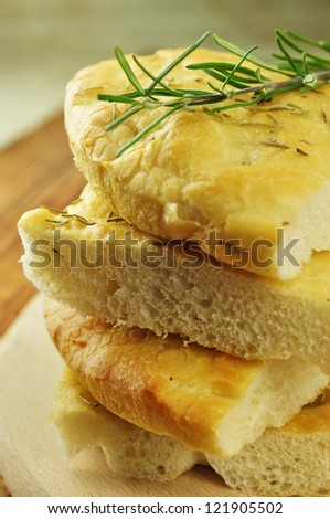 Focaccia with rosemary, olive oil and coarse salt, selective focus - stock photo