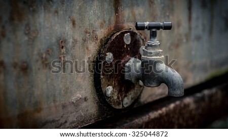 focus and blurred  a rusty old faucet - stock photo