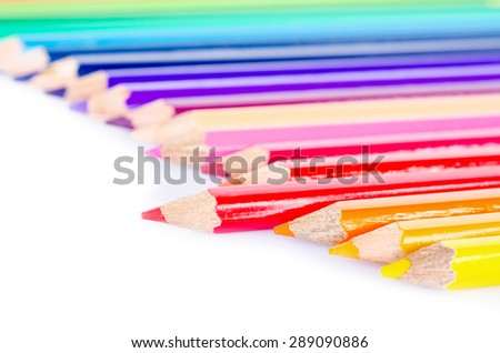 Focus at red colored pencil with many colored pencil on white background. - stock photo