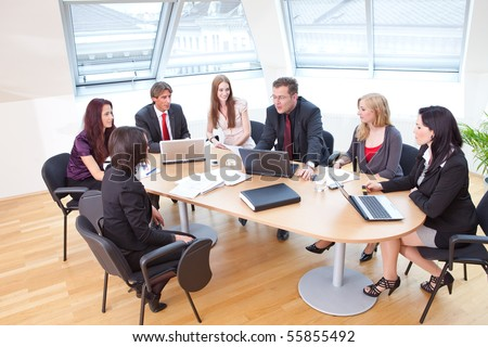focus group on a business meeting in a modern office - stock photo