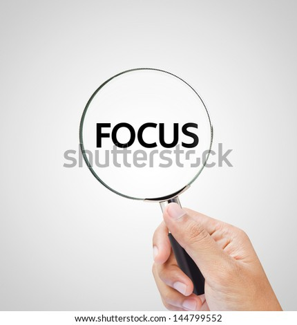 focus letters under the magnifier - stock photo
