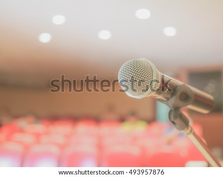 focus microphone, background speaker in the conference hall, speaker on the stage, modern technology with microphone made with vintage filter