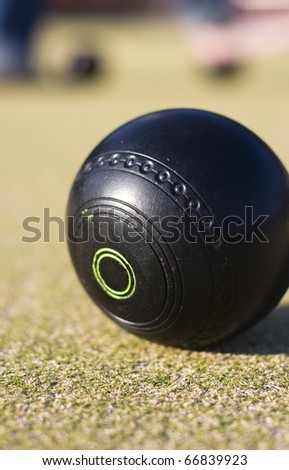 Focus On A Lawn Bowls Ball With A Low Depth Of (The) Field - stock photo