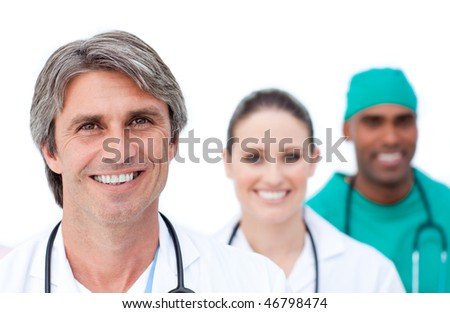 Focus on a mature doctor in front of his team against a white background