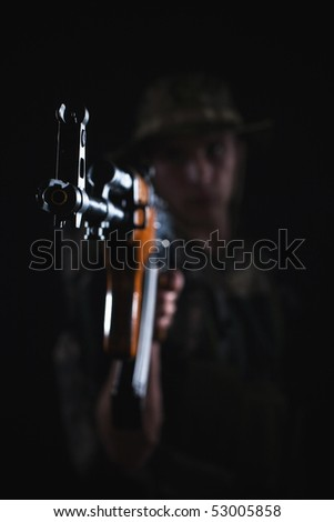 Focus on aiming Kalashnikov assault rifle being held by soldier.