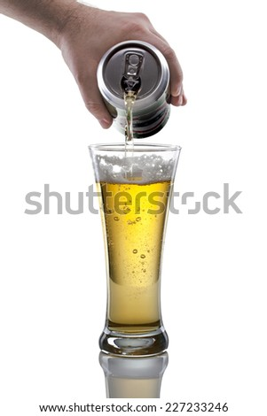 focus on beer glass. Pouring beer on the white background