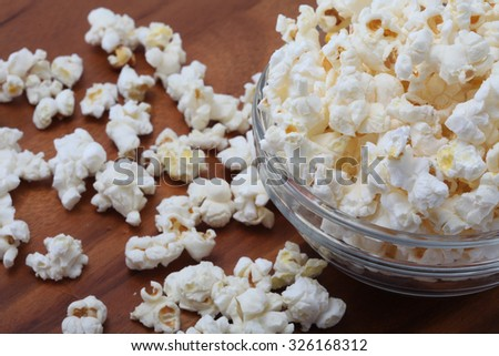 focus on salty popcorn in a transparent bowl ready to serve - stock photo