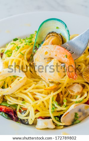 Focus on shrimp in spagetthi dish - stock photo