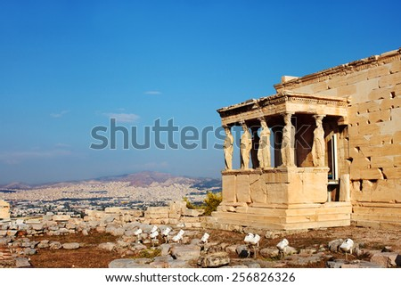 Focus on the Caryatids columns with Athens in the background. Part of the Erechtheion temple in the Acropolis. Athens, Greece. - stock photo