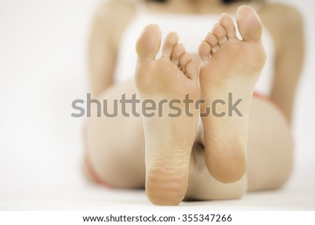 Focus on the her feet, studio shooting, selective focus - stock photo