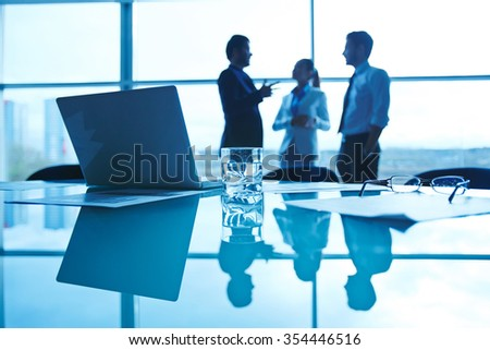 Focus on the things on the table. Blurred people on the background - stock photo