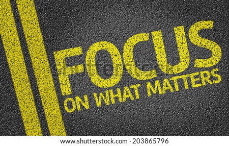 Focus on What Matters written on the road - stock photo