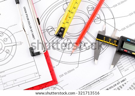 Focus pencil,  measuring tape and Plans document and vernier caliper on plans