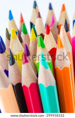 Focus red color wooden pencil and many color pencil on white background. - stock photo