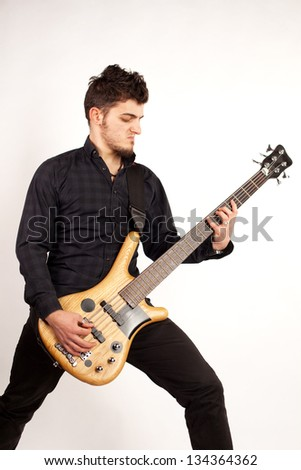 Focused bass player in black