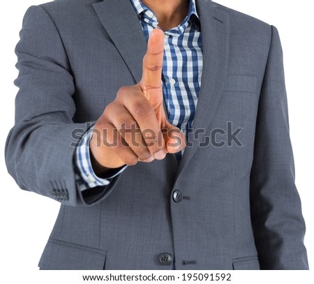 Focused businessman pointing on white background