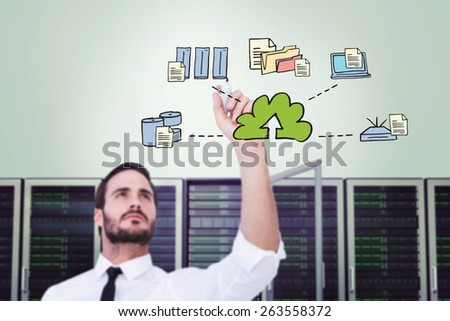 Focused businessman writing with marker against cloud computing doodle - stock photo