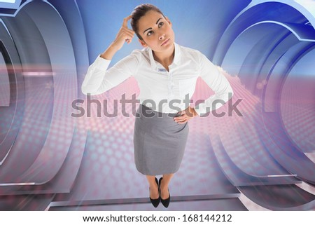Focused businesswoman against cloud design on a futuristic structure
