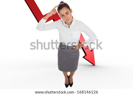 Focused businesswoman against red arrow pointing down - stock photo