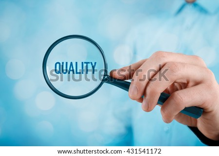 Focused on quality concept. Quality manager (businessman, coach, leadership) is focused on quality in business (total quality management concept). - stock photo