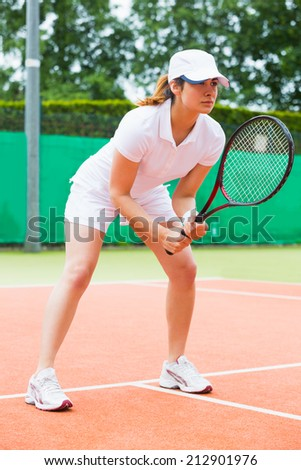 Focused tennis player ready for match on a sunny day