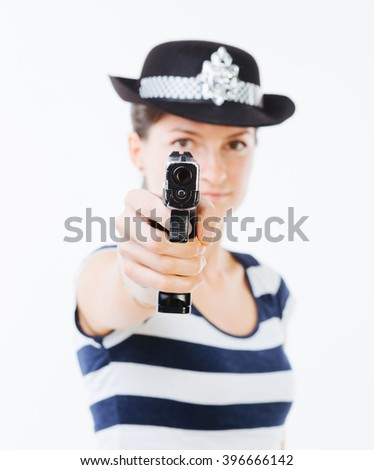 Focused woman cop aiming the revolver to the camera - isolated on white . - stock photo