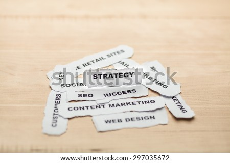 Focusing of strategy paper rip with soft style on wood background - stock photo