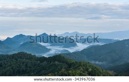 fog and cloud mountain valley landscape at Doi Ang Khang, Chiang Mai, Thailand - stock photo