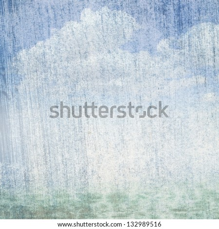 Fog and clouds on a vintage, textured paper background with a color gradient. - stock photo