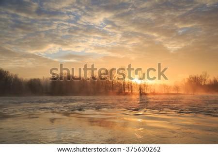 Fog at the Rhone river near Lyon during a winter sunrise. - stock photo