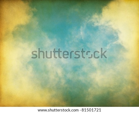 Fog, clouds, and sky on a textured vintage paper background. - stock photo