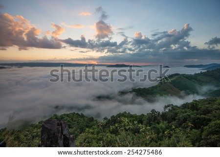 Fog in mountain before sunrise in thailand - stock photo